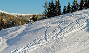 backcountry ski slope with track marks